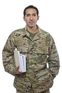 Image of Male Service Member with school books